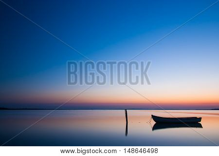 Mystical sea with boat. Abstract natural backgrounds. scene after sunset