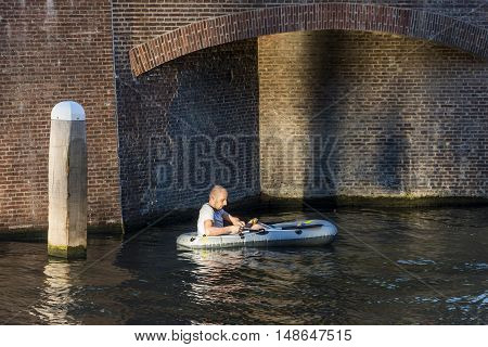 Utrecht The Netherlands - August 6 2016: Man at Rubber Boat Mission in Utrecht world record The Netherlands