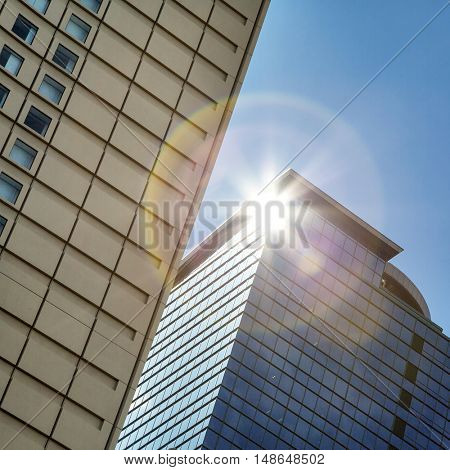 Skyscraper detail with natural lens flare.