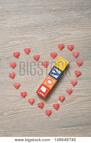Valentine's Day. Love Spelled with colorful alphabet blocks with a candy heart