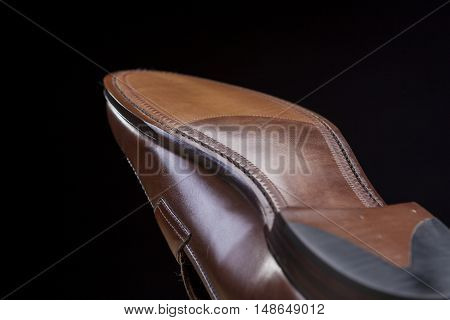 Downward Side of Penny Loafer Natural Leather Sole. Closeup Shot. Horizontal Image Composition