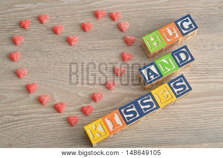 Valentine's Day. Hugs and kisses Spelled with colorful alphabet blocks and a candy heart.