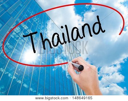 Man Hand Writing Thailand  With Black Marker On Visual Screen