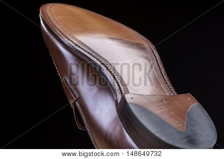 Footwear Ideas. Downward Side of Penny Loafer Natural Leather Sole. Closeup Shot. Horizontal Image Composition