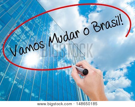 Man Hand Writing Vamos Mudar O Brasil! (let's Change Brazil In Portuguese)  With Black Marker On Vis