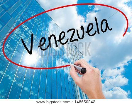 Man Hand Writing Venezuela With Black Marker On Visual Screen