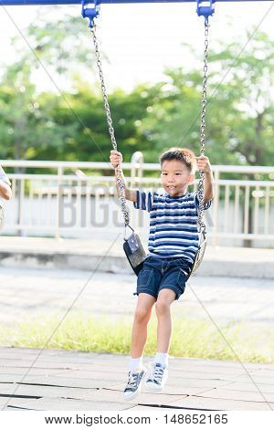 Asian Boy Play With Swinging. With Swinging.