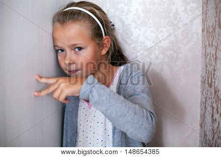 Close up portrait of a girl playing with her fingers