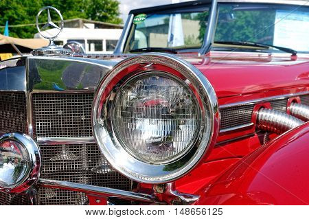 Kharkiv Ukraine - May 22 2016: Close up of retro car red Mercedes-Benz Cabriolet manufactured in 1934 is presented at the festival of vintage cars Kharkiv Retro Rally - 2016 in Kharkiv Ukraine on May 22 2016