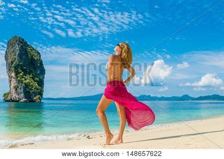Classy woman on the Thai beach of Poda in Krabi