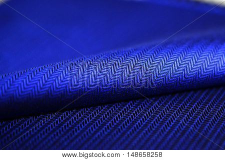 close up blue fabric of shirt photo shoot by depth of field for object