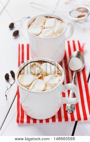 Vintage hot cup of cocoa or chocolate with marshmallows on wooden background. Winter christmas concept.
