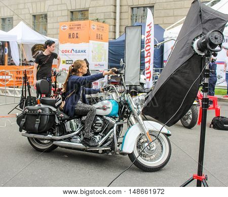 St. Petersburg, Russia - 12 August, Young girl on a motorcycle,12 August, 2016. The annual International Festival of Motor Harley Davidson in St. Petersburg Ostrovsky Square.