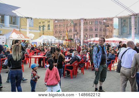 St. Petersburg, Russia - 12 August, People at the tables at the festival Harley Davidson,12 August, 2016. The annual International Festival of Motor Harley Davidson in St. Petersburg Ostrovsky Square.