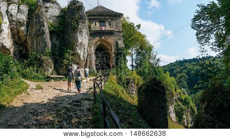 OJCOWICE, POLAND - SEP 03, 2016: Entering the ruins of the castle can be seen from a distance already Ojcowa located on a high rock on the right side of the road.