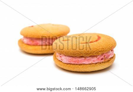 Smiley dessert cookies isolated on white background