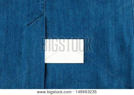 Blank business card with copy space in a pocket of blue jean top view