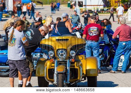 York PA - September 23 2016: Enthusiasts inspect new motorcycles at the Harley-Davidson annual open house.