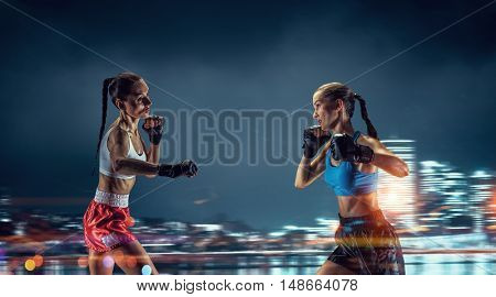 Girls boxing outdoor . Mixed media