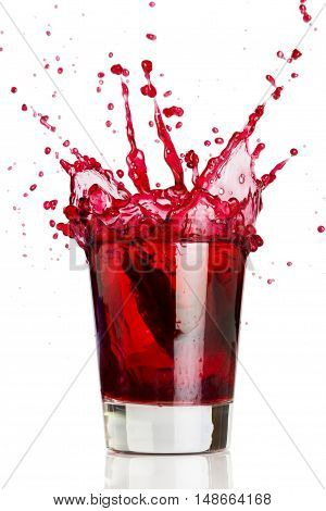 A glass of grape juice isolated on white background