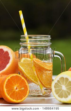 Fruits juice. fruit lemonade. Mandarin lemon orange fruits.