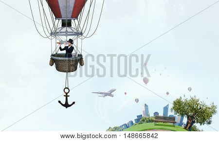 Woman traveling in aerostat . Mixed media