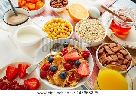 Breakfast healthy cereal coffee and orange juice with berries