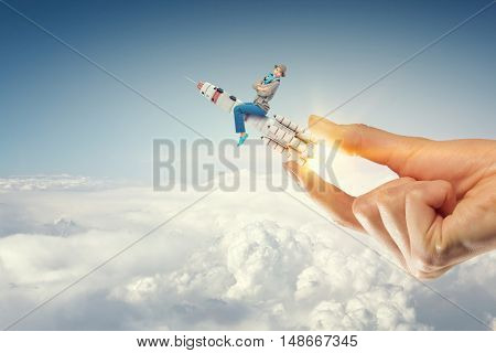 Hand giving rocket . Mixed media