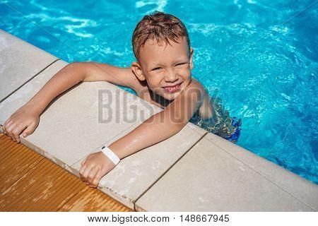 Little Boy Learning To Swim.