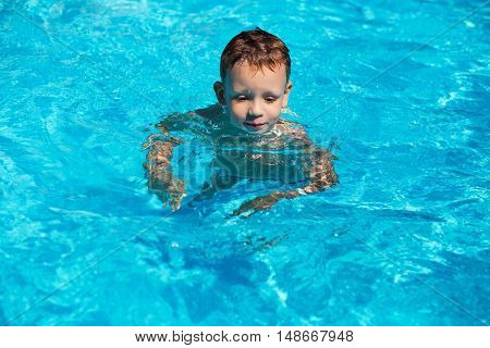 Cute Kid, Boy Swimming In Pool Water