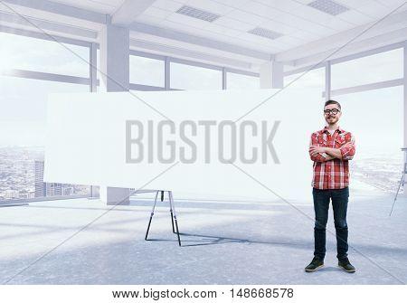 Guy near blank banner . Mixed media
