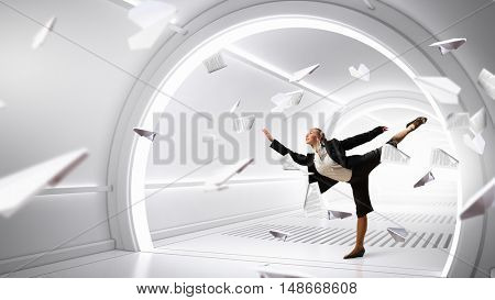 Dancing businesswoman in virtual room . Mixed media