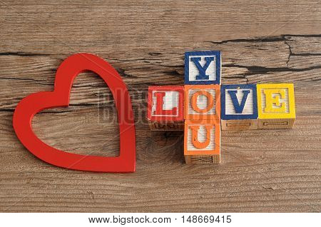Valentine's Day.Love you Spelled with colorful alphabet blocks and a red heart