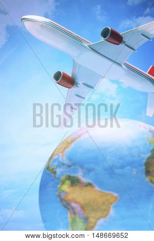Airplane toy above globe studio shot