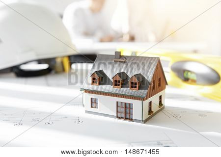 Design And Architecture. Caucasian Engineer Working On Drawings Of New Housing Project, Sitting In O
