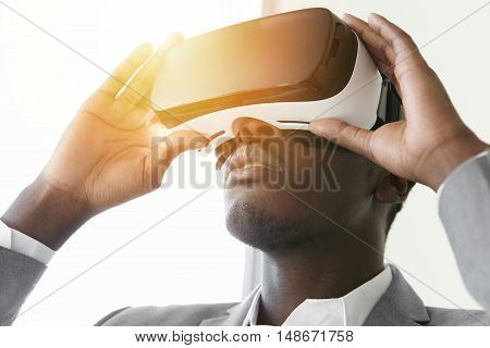 Close Up Of Dark-skinned Player Dressed In Formal Wear With Virtual Reality Headset Or 3D Glasses On