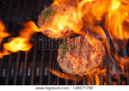 food meat - burgers on party summer barbecue grill with flame. Live action shot