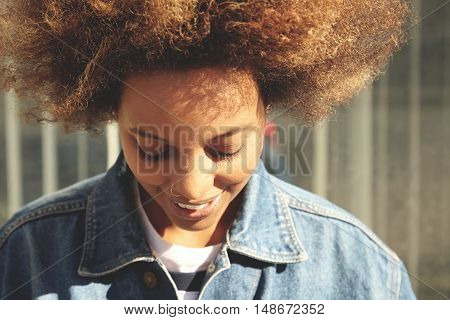 People And Lifestyle. Beautiful African Female With Healthy Skin And Nose-ring Posing At Gray Wall,