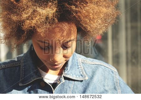 Close Up Portrait Of Hipster Dark-skinned Girl With Afro Haircut And Nose-ring, Dressed In Trendy De