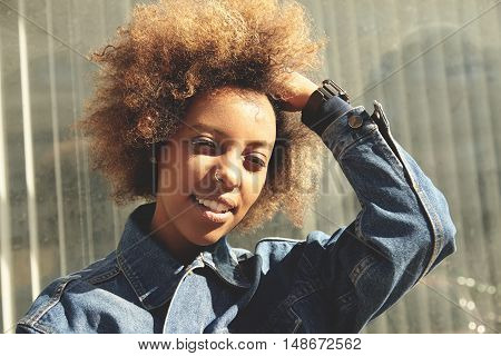 People And Lifestyle. Hipster Dark-skinned Girl With Ring In Her Nose, Wearing Trendy Clothes Lookin