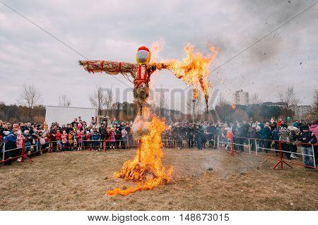 Gomel, Belarus - March 12, 2016: The Scene Of Burning On Bonfire The Dummy As Winter And Death Symbol In Slavic Mythology, Pagan Tradition. The Oldest Surviving Eastern Slavic Folk Holiday Maslenitsa