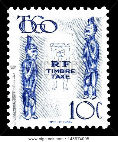 TOGO - CIRCA 1947 : Cancelled postage stamps printed by Togo, that shows Carved figures.
