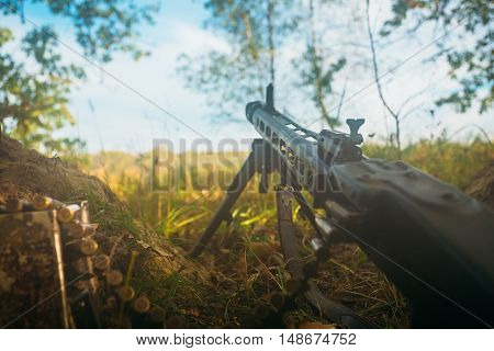 German military ammunition - machine gun of World War II on ground in trench.