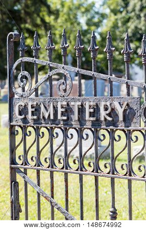 Black wrought iron old style cemetery gate.