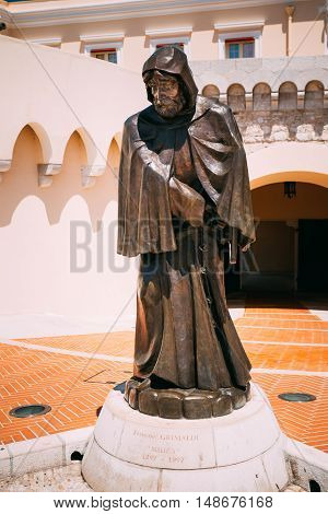 Monte-Carlo, Monaco - June 28, 2015: Statue of Francois Grimaldi disguised as a monk with a sword under his frock before the Prince's Palace of Monaco