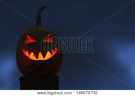 pumpkin head with a fire in the middle of the sky against a background of terrible, holiday, October 31, Halloween