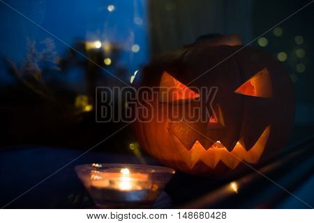 Dark Halloween Pupkin Symbol Behind The Home Window With Light Reflectons