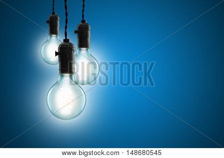Idea Concept - Vintage Incandescent Bulbs On Blue Background