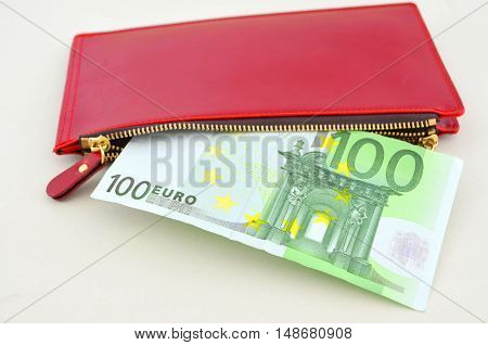 Evro bills in a red woman's purse