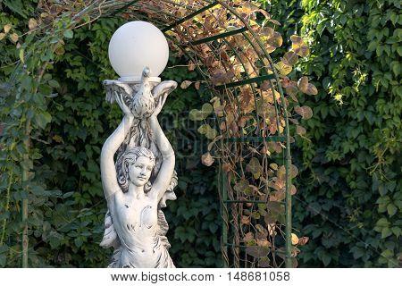 Sculpture Of The Girl In A Summer Garden